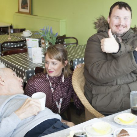 Disabled man drinking tea in cafe
