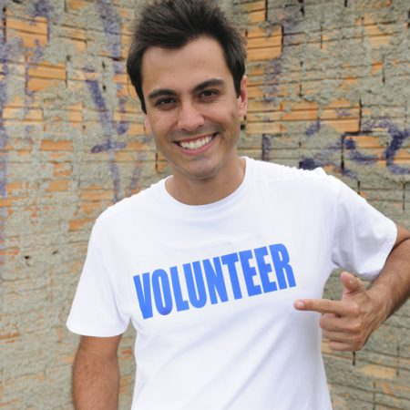 Man with volunteer t-shirt