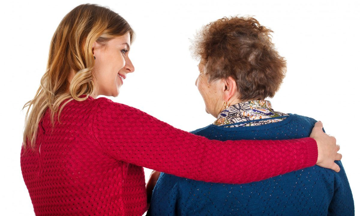 Young woman comforting older woman