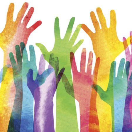 Multicoloured raised hands