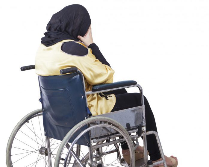 Woman wearing headscarf in wheelchair